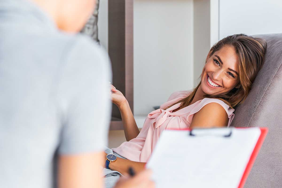 woman smiling experiencing the benefits of therapy